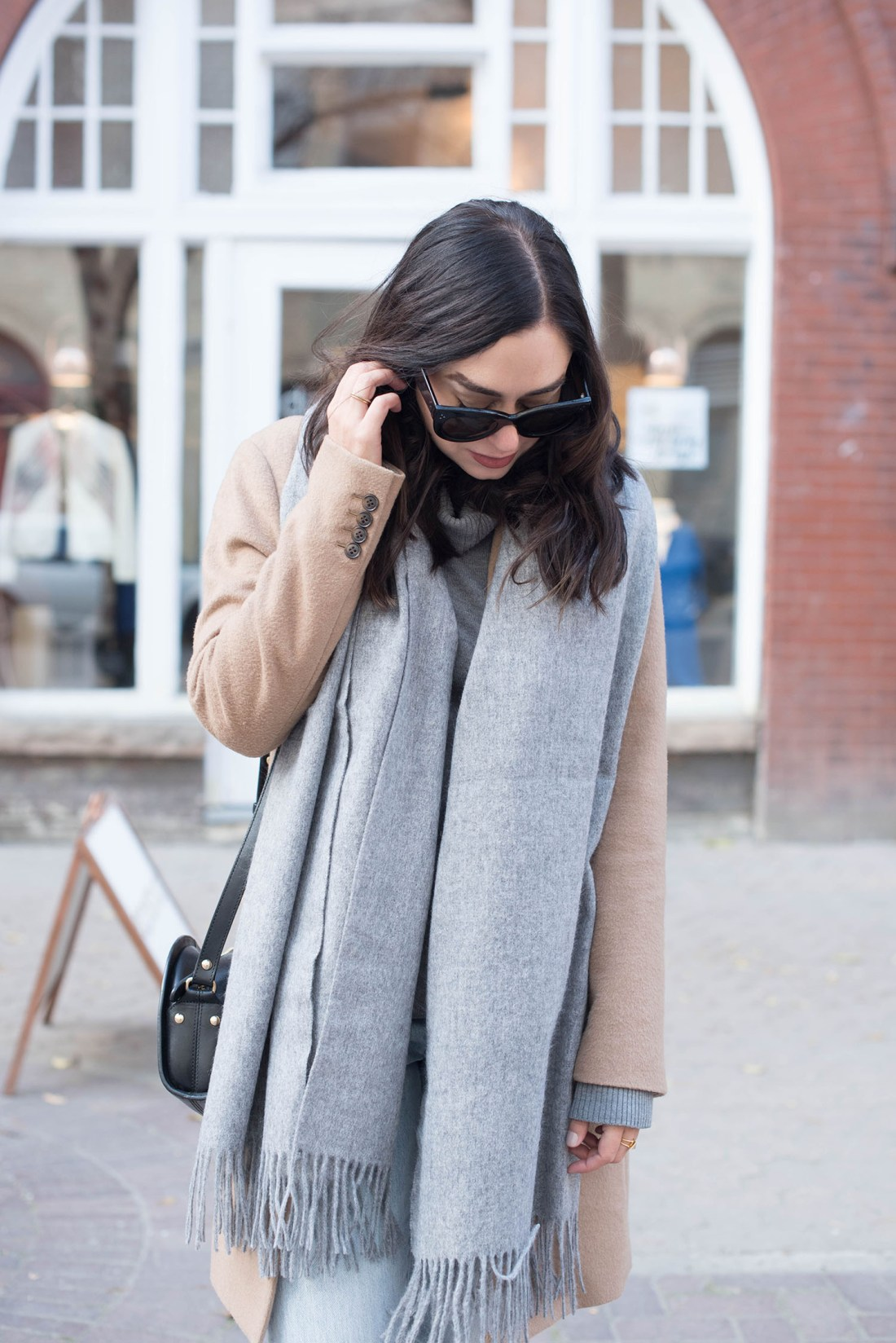 Portrait of fashion blogger Cee Fardoe of Coco & Vera wearing an ASOS wool scarf and Celine Audrey sunglasses