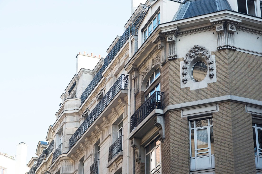 A brown and cream brick building in Paris, as photographed by top Canadian travel blogger Cee Fardoe of Coco & Vera