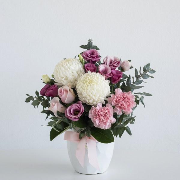 very popular pastel flowers in white geometric vase