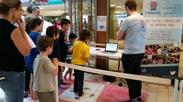 kids playing dance dance revolution with makey makey