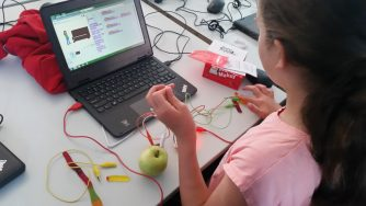 child using makey-makey