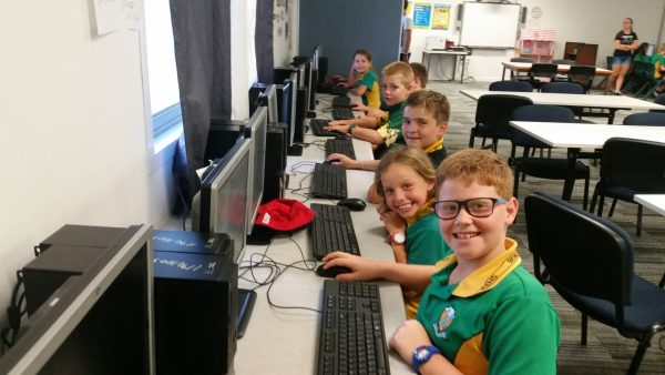 Coding kids students smiling