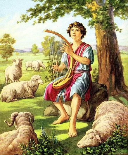 The boy David plays a harp while tending sheep