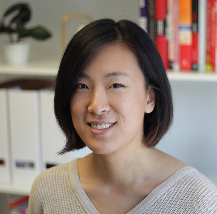 Portrait of Caitlin Chu in a beige sweater.