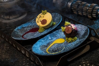Innovative and creative eats from around the galaxy will be available at Star Wars: Galaxy's Edge when it opens May 31, 2019, at Disneyland Park in Anaheim, Calif., and Aug. 29, 2019, at Disney's Hollywood Studios in Lake Buena Vista, Fla. Guests can indulge in a raspberry crme puff with passion fruit mousse (left) or chocolate cake with white chocolate mouse and coffee custard (right) at Docking Bay 7 Food and Cargo inside Star Wars: Galaxy's Edge. (David Roark/Disney Parks)