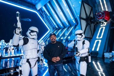 """Shark Tank"" star Daymond John poses with First Order Stormtroopers inside Star Wars: Rise of the Resistance at Disney's Hollywood Studios, Dec. 3, 2019, in Lake Buena Vista, Fla. The groundbreaking new attraction opens Dec. 5, 2019, at Walt Disney World Resort and Jan. 17, 2020, in Disneyland Park in Anaheim, Calif. (Matt Stroshane, photographer)"