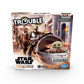 """TROUBLE: STAR WARS THE MANDALORIAN EDITION Game (HASBRO/Ages 5 years & up/Approx. Retail Price: $14.99/Available: Spring 2020) Inspired by the THE MANDALORIAN live-action TV series on Disney Plus, this TROUBLE: STAR WARS THE MANDALORIAN EDITION Game combines TROUBLE gameplay with THE MANDALORIAN adventures. Race around a dangerous planet in the outer reaches of the galaxy to rescue THE CHILD, who fans call """"BABY YODA"""". Choose to play as bounty hunter, THE MANDALORIAN, IG-II the droid, the skilled warrior, CARA DUNE, or the vapor farmer, KUILL. The first player to get all 4 of their pawns to the Home space to rescue THE CHILD wins! This game makes a fun choice for Family Game Night and it's a great gift for STAR WARS THE MANDALORIAN fans. This game is for 2 to 4 players. Includes plastic game unit base with Pop-O-Matic die roller, cardboard gameboard insert, 16 plastic character pawns (4 of each color), label sheet, and instructions. Available at Amazon and Walmart."""