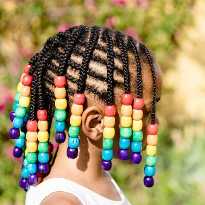 little girl braided hairstyle with wooden beads