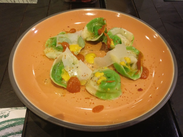 Broccoli and potato ravioli, cherry tomato and basil sauce