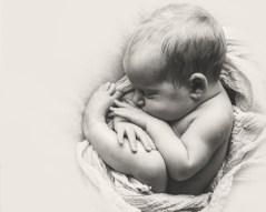 Snuggled up newborn