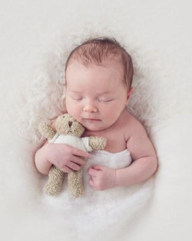 newborn baby photography with teddy