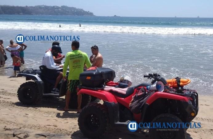 Salvan a 3 turistas de Jalisco de ahogarse en playa Olas Altas de Santiago