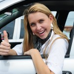 Happy_Woman_Driving_A_New_Car
