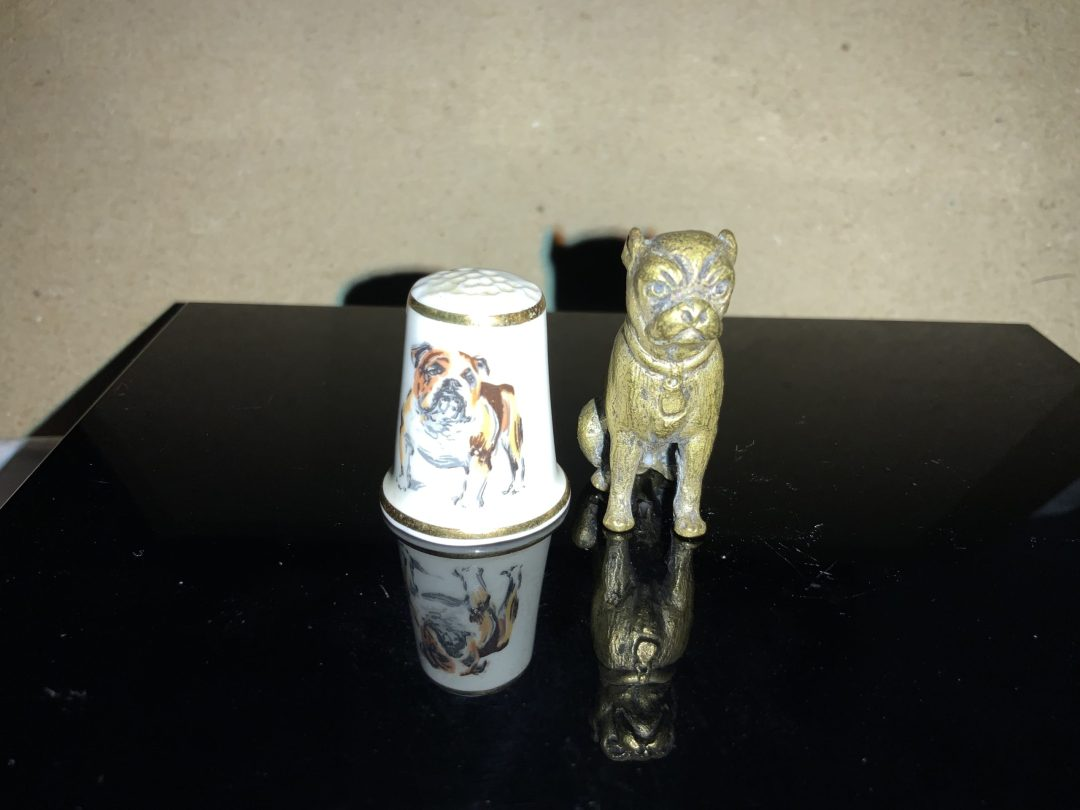 Amazing thimble sized bulldog statuettes
