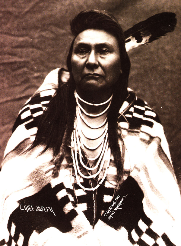 """Chief Joseph wears a Pendleton blanket in 1901. He is famous for leading a long-standing resistance to the U.S. government, which had ordered the Nez Perce to move to an Idaho reservation. Photo by Major Lee Morehouse, courtesy of Bob Kapoun, via """"Language of the Robe."""""""