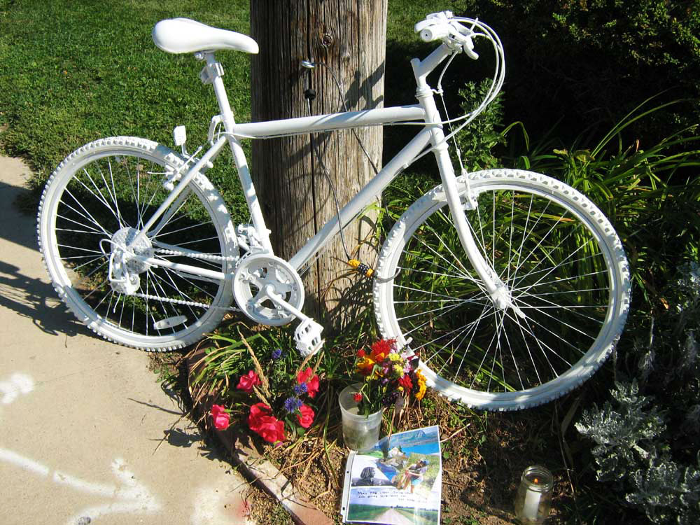 Ghost bikes have been installed on roadways across the country where cyclists were killed by motorists, like this bike in Boulder, Colorado, in memory of Matthew Powell in 2008.