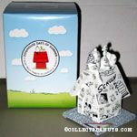 Snoopy on doghouse covered in comics Figurine