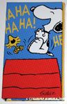 Snoopy & Woodstock laughing on top of doghouse Notepad