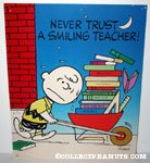 Charlie Brown with wheelbarrow of books 'Never trust a smiling teacher' Poster