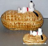 Snoopy laying on top of peanut Nut Dishes