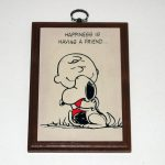 Snoopy hugging Charlie Brown 'Happiness is having a friend' Plaque