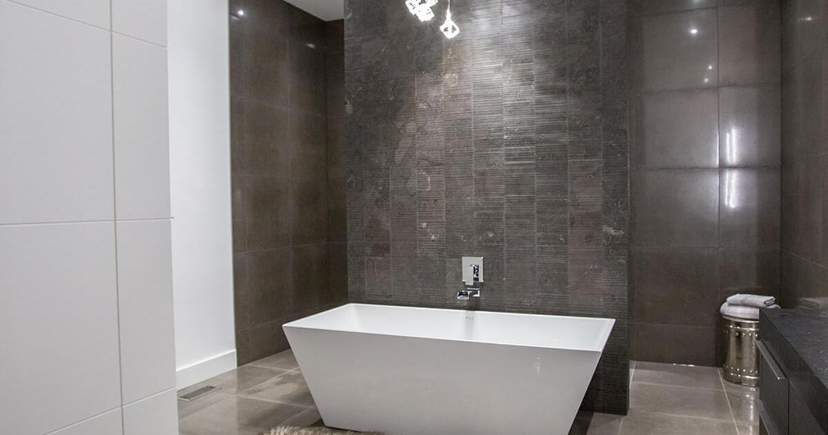 CONTEMPORARY ENSUITE DARK TEXTURED STONE WITH METALLIC TILE COLLEEN FERGUSON DESIGN CALGARY INTERIOR DESIGNER