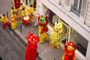 Chinese New Year 2011 Lion Dance at shops along rue Sedaine in the Bastille, Paris