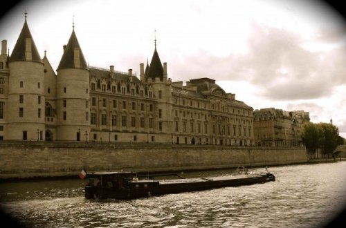 Barge on Seine Passing in front of the Conciergerie
