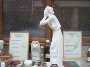 Herboristerie de la Place Clichy 87 Remedies and Figurine in Window