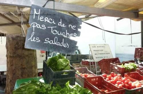 Please do not touch the lettuce written on a blackboard