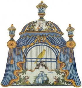 Bird cage produced in Delft (1780) was meant to be hung or blended in with tiles. Artwork meant for the new bourgeoisie.