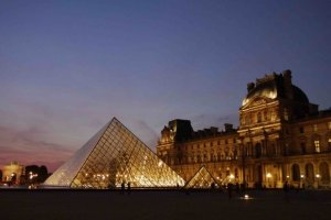 Entering the courtyard of the Louvre from Cour Carrée looking at the pyramids and the north wing and Richelieu passage
