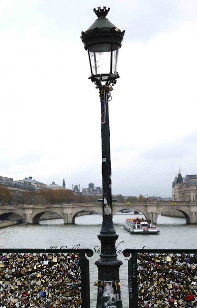 Padlocks on lamp post Pont des Arts bridge