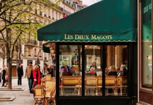 Les Deux Magots side view with lady in long red scarf