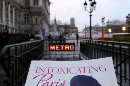 "Partial book cover ""Intoxicating Paris"" by PJ Adams with Metro, Hotel de Ville plaza and Notre-Dame in the background"