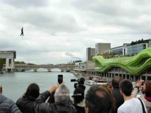 Denis Josselin crossing the Seine with Cité des Art et du Design to the right