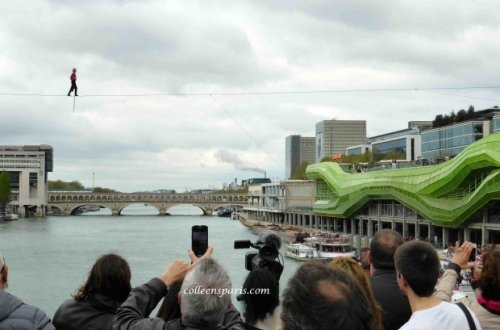 Denis Josselin crossing the Seine with Cité des Art et du Design to the right