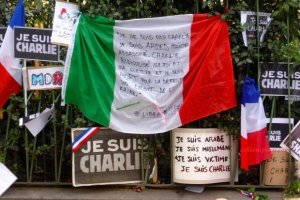 Flag and signs honoring Ahmed Merabet Paris