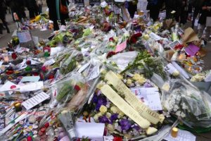 Flowers, candles and tributes near the offices of Charlie Hebdo