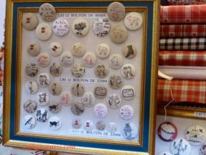 Variety of decorative buttons in a frame in various sizes Aiguille en Fete