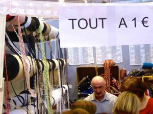 "Sign that reads everything for one euro ""tout a 1 euro"" Aiguille en Fete"