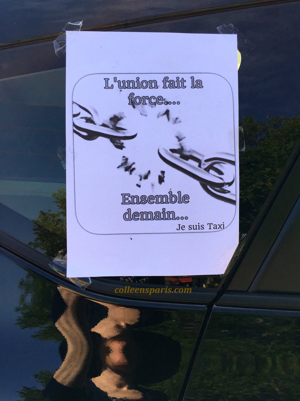 """Taxi Strike at the Bastille and taxis had this sign taped on to their windows """"L'union fait la forcee..ensemble demain"""" (""""United we are strong....Together tomorrow"""" Je suis Taxi"""