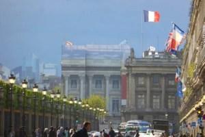 French flags flying rue de Rivoli with Hotel de la Marine & Hotel de Crillon in the background