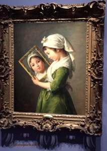 Young Jeanne Julie Louise Le Brun looking at herself in a mirror (1787). Also demonstrates how self-portraits were painted using a mirror