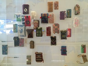 Telephone cases link the traditional with the modern world, embroidered, decorated with motifs used for centuries in family and religious ceremonies and traditions. Musee de l'Homme