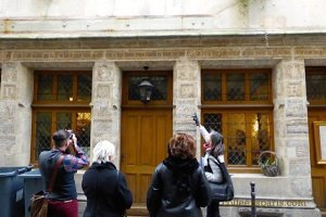 Rosemary pointing out writing on the front of the House of Nicolas Flamel