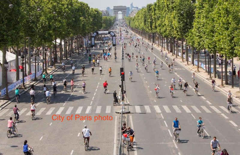 View of Champs Elysees with cyclists-May 8 is first Sunday pedestrian opening