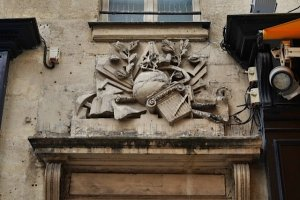 Franc-Maconnerie symbols on facade above doorway at 51 rue Montorgueil