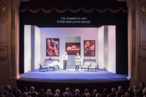 audience and surtitles for play The Lie Theatre in Paris