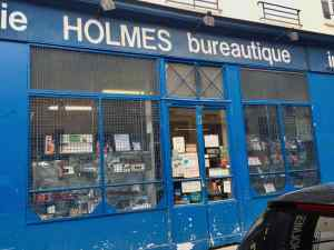 Image of Holmès storefront before they closed Bastille Paris